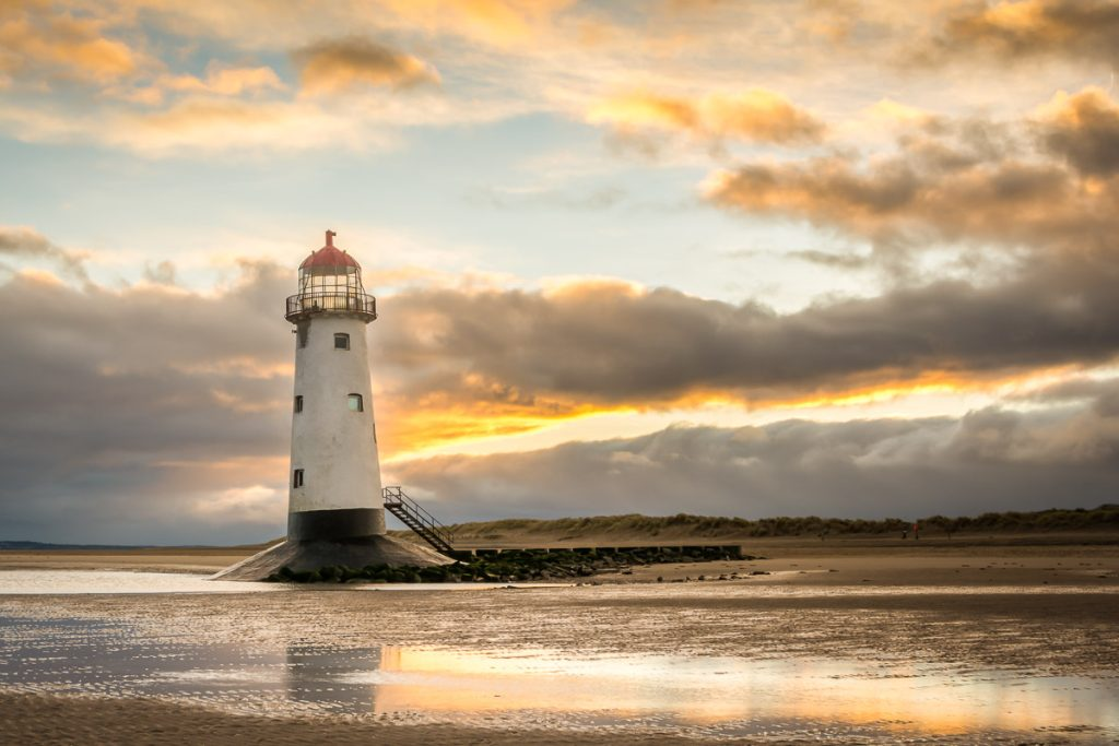 Point of Ayr Lighthouse bathed in golden light