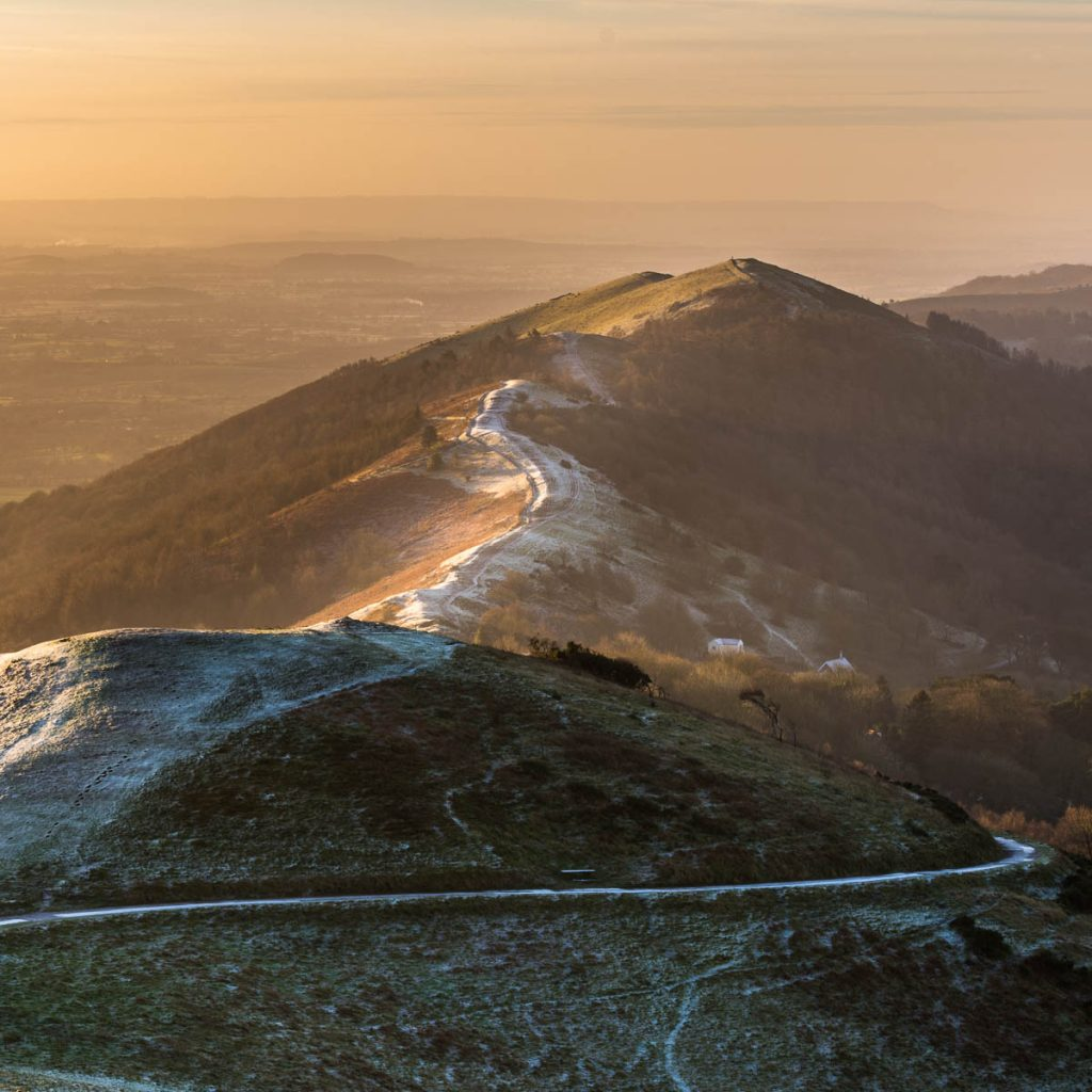 The view from the Worcestershire Beacon looking towards Wyche cutting during a Malvern Hills sunrise